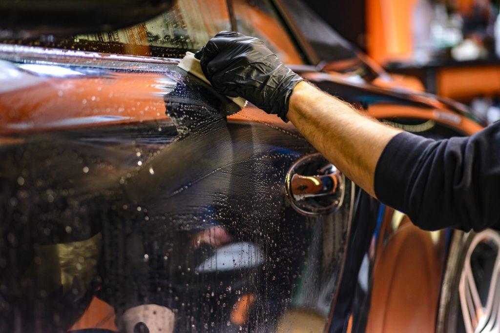 man doing car polish